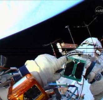 Image: Russian cosmonaut, Oleg Artemyev, deploys a Peruvian satellite