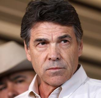 Image: File photo of Texas Governor Perry answering questions from the media after taking an aerial tour over the fertilizer plant explosion site in West Texas