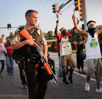 Image: Demonstrators protest the killing of teenager Michael Brown on Aug. 19