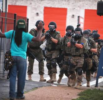 Image: Police force protesters from the business district into nearby neighborhoods on August 11, 2014 in Ferguson, Missouri