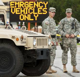 Image: Missouri National Guard soldiers stand by at a police command post in Ferguson