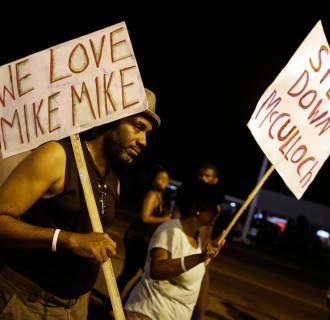 Image: Protesters march in Ferguson, Mo.