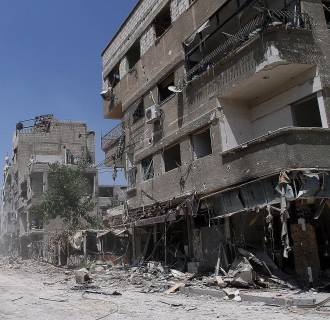 Image: Ruined buildings in El-Muleyha region in Syria