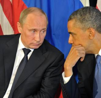 Image: Barack Obama talks to Vladimir Putin on June 18, 2012