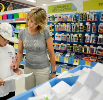 Mother and son back-to-school shopping