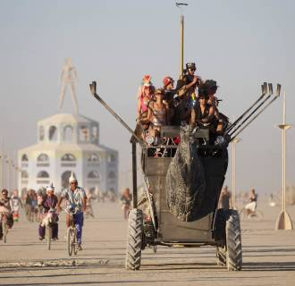 Image: Participants ride an art car during the Burning Man 2012