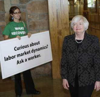 Federal Reserve chief Janet Yellen says labor markets are still hampared by effects of the recession and the Fed should act cautiously in raising interest rates.