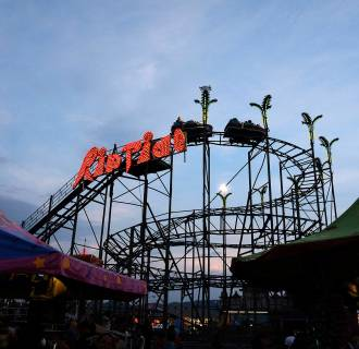 Image: Fair goers ride the Riptide roller coaster at the Salem Fair, in Salem, Va., Sunday July 13, 2014.