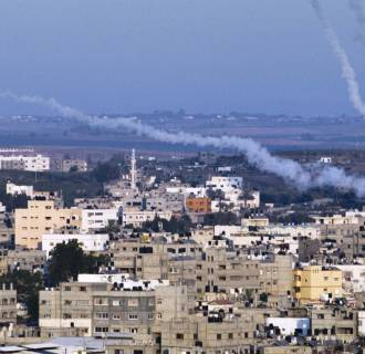 Image: Smoke trails mark the path of Palestinian missiles fired from the north-east of Gaza City on Aug. 21.