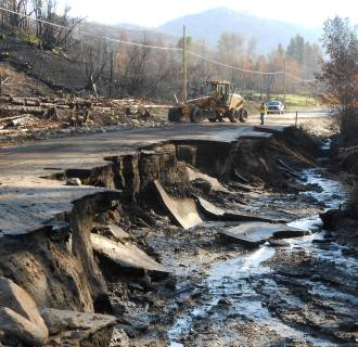 Image: Crews work near a damaged road east of Twisp, Wash., on Aug. 22.