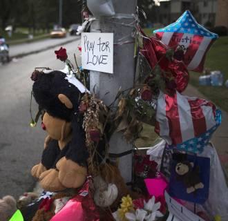 Image: A makeshift memorial is seen near the site where unarmed teen Michael Brown was shot dead in Ferguson, Missouri