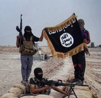 Image: Militants of the Islamic State of Iraq and the Levant (ISIL) posing with the trademark Jihadists flag after they allegedly seized an Iraqi army checkpoint in the northern Iraqi province of Salahuddin in this photo released on June 11
