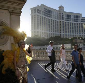 Image: Pedestrians walk by the Bellagio on Aug. 15, 2014, in Las Vegas.
