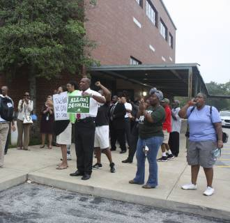 Teachers welcome students back to Normandy High School