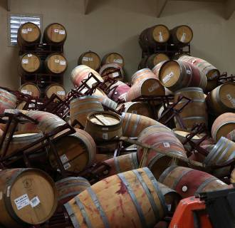 Image: Image: A mound of toppled wine barrels sit in a storage room at Kieu Hoang Winery on Aug. 25, 2014, in Napa, California.