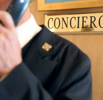 Image: A concierge of a luxury hotel takes a reservation
