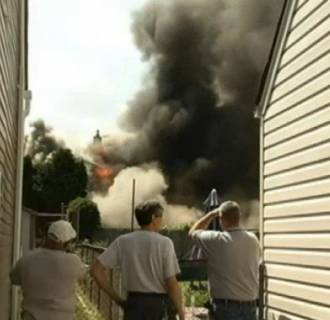Flames engulfed a home in Clifton, New Jersey, Tuesday afternoon.