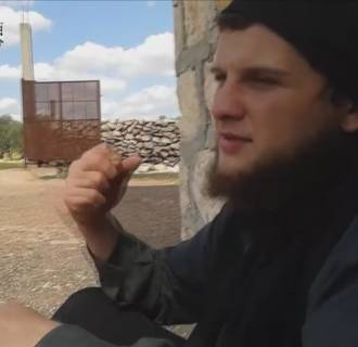 Image: A screengrab from a video interview with Moner Mohammad Abusalha, the first American suicide bomber to die in Syria, released by Bilad Al-Sham Media