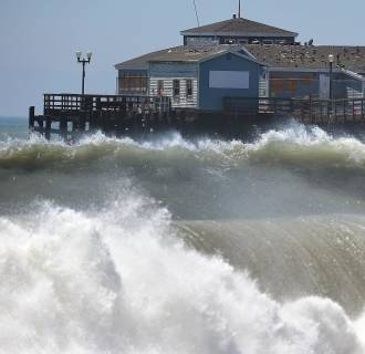 Image: Big waves crash ashore and into the pier at Seal Beach, Calif., on Aug. 27,
