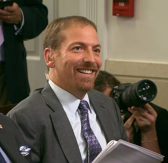 Image: NBC News' Chuck Todd smiles as President Obama acknowledges him