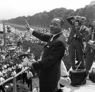 Image: Civil rights leader Martin Luther King waves to supporters from the steps of the Lincoln Memorial