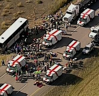 Image: Emergency personnel attend to people injured in a bus crash 20 miles south of Merritt, British Columbia, Canada.