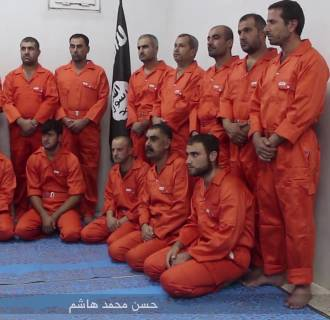 A still from a propaganda video released by ISIS showing a dozen hostages alleged to be Kurdish forces.