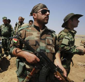 Image: Kurdish Peshmerga forces guard their position at Omar Khaled village near Tal Afar, west of Mosul