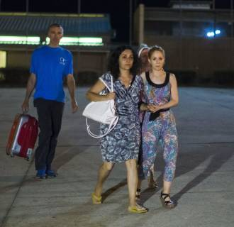 Image: Brett and Naghemeh King, left and center, leave Soto Del Real prison