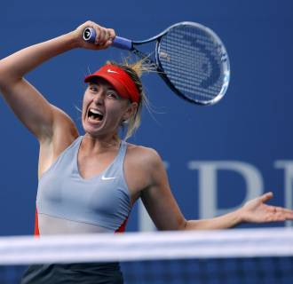 Image: Maria Sharapova of Russia hits a return to Caroline Wozniacki of Denmark during their match at the 2014 U.S. Open tennis tournament in New York