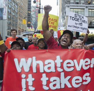 Image: People picket at a McDonalds