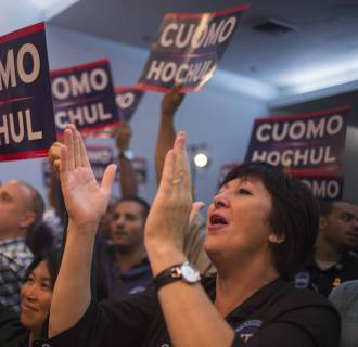 Image: Supporters cheer for New York Governor Cuomo as he speaks during a re-election campaign stop a day ahead of the Democratic primary in New York