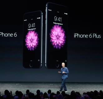 Image: Tim Cook; iPhone 6; iPhone 6 Plus