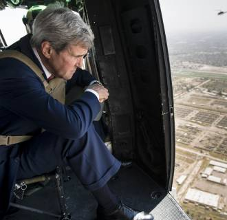 Image: Secretary of State John Kerry looks out over Baghdad