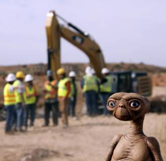 Image: An  E.T. doll is seen while construction workers prepare to dig into a landfill in Alamogordo, N.M.,