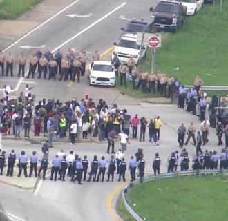 Image: Protestors marching on Interstate 70 in Ferguson, Missouri