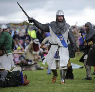 Image: Actors take part in a reenactment to commemorate the 700th anniversary of the Battle Of Bannockburn