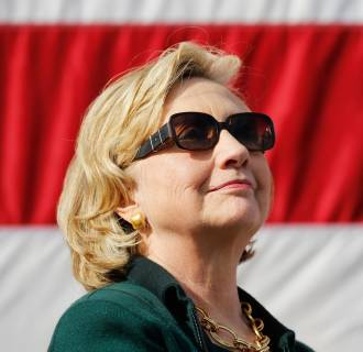 Image: Former U.S. Secretary of State Hillary Clinton listens to speeches at the 37th Harkin Steak Fry in Indianola