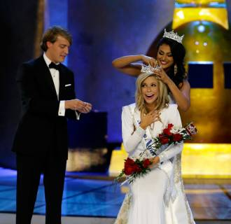 Image: Miss America 2014 Nina Davuluri, top right, crowns Miss New York Kira Kazantsev as Miss America 2015