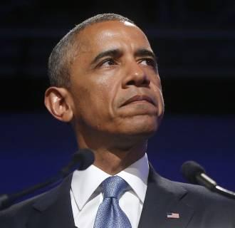 Image: President Barack Obama pauses