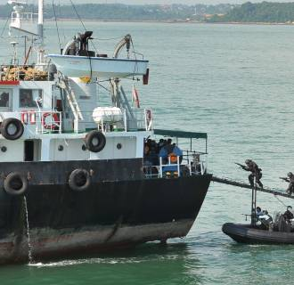Indonesian Navy Kopaska troops storm the