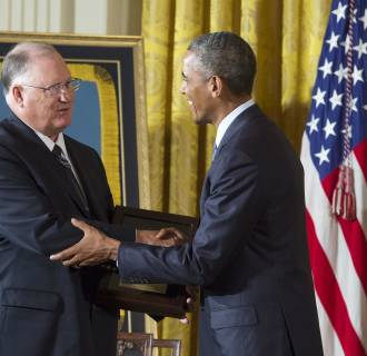 Image: William Sloat (L) of Enid, Oklahoma, accepts the Medal of Honor on behalf of his late brother
