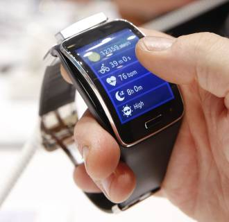 Image: A visitor holds a Samsung Gear S smartwatch at the IFA consumer technology fair in Berlin