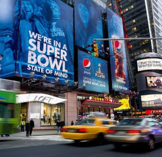 Image: Large signs advertising the Super Bowl