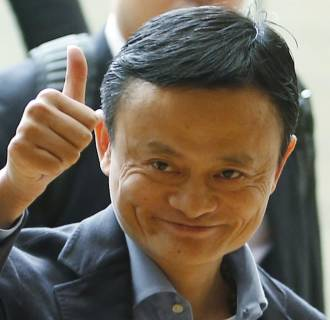 Image: Alibaba founder Jack Ma gives a thumbs up as he arrives to speak to investors at an initial public offering roadshow in Singapore