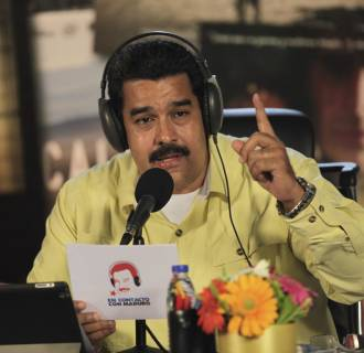 Image: Venezuela's President Maduro speaks during his radio program in Caracas