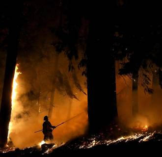 Image: A firefighter monitors a backfire as he battles the King Fire on Sept. 17.