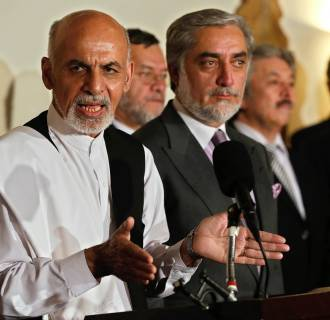 Image: Afghan presidential candidates Ashraf Ghani and Abdullah Abdullah attend a joint press conference in Kabul on July 12.