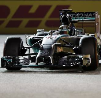 Image: Mercedes Formula One driver Hamilton of Britain drives during the qualifying session at the Singapore F1 Grand Prix at the Marina Bay street circuit in Singapore