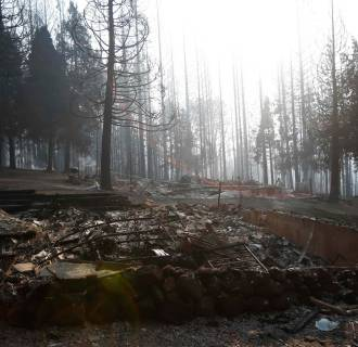 Image: The remains of a structure burned by the King Fire is seen in White Meadows, northeast of Sacramento, California